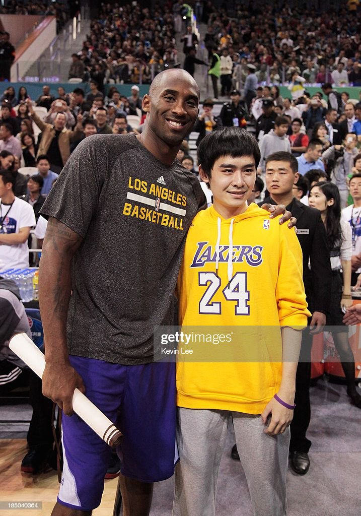 <a gi-track='captionPersonalityLinkClicked' href=/galleries/search?phrase=Kobe+Bryant&family=editorial&specificpeople=201466 ng-click='$event.stopPropagation()'>Kobe Bryant</a> of the Los Angeles Lakers poses with a fan at NBA Fans Appreciation day on October 17, 2013 in Shanghai, China.