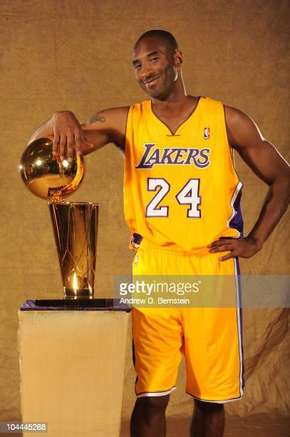 Kobe Bryant of the Los Angeles Lakers poses with the Larry O'Brien trophy at Media Day at Toyota Sports Center on September 25 2010 in El Segundo...
