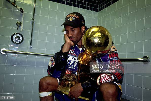Kobe Bryant of the Los Angeles Lakers poses with the NBA Championship trophy after defeating the Philadelphia 76ers in game five of the 2001 NBA...