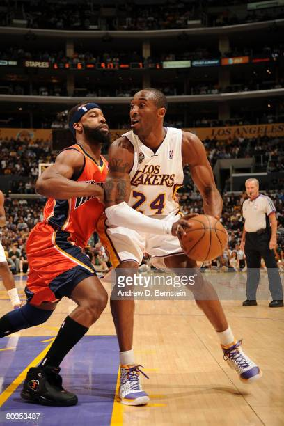 Kobe Bryant of the Los Angeles Lakers prepares to go up for a shot while being guarded by Baron Davis of the Golden State Warriors during the first...