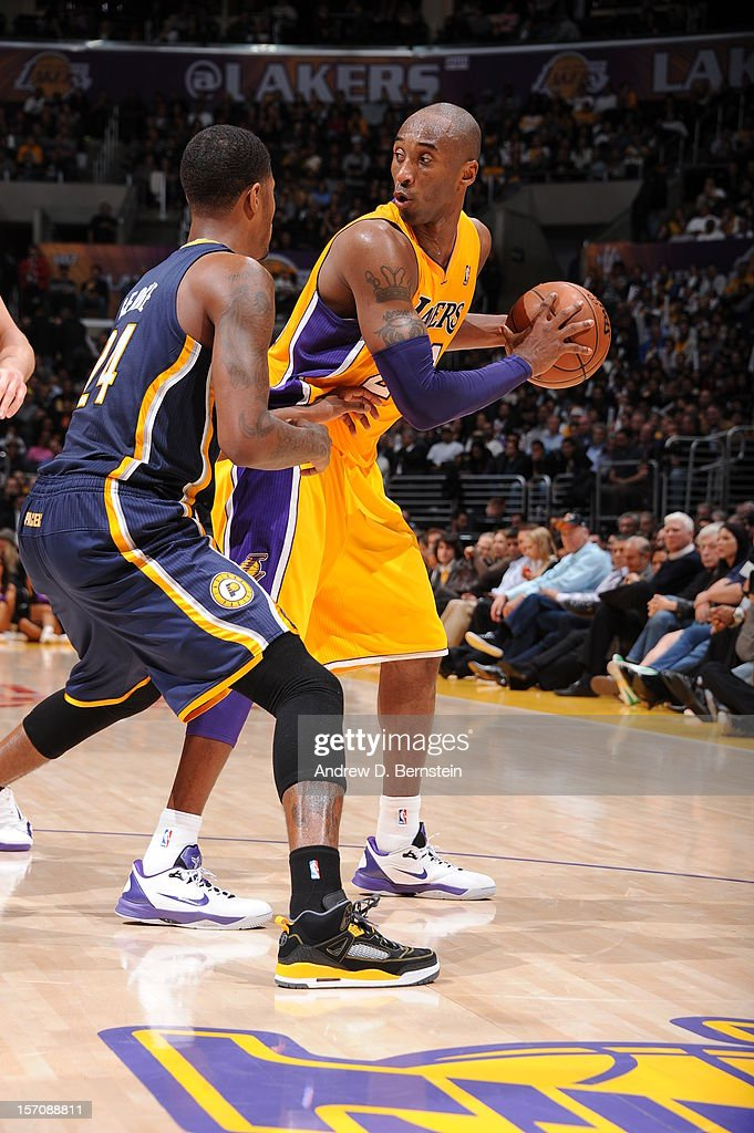 <a gi-track='captionPersonalityLinkClicked' href=/galleries/search?phrase=Kobe+Bryant&family=editorial&specificpeople=201466 ng-click='$event.stopPropagation()'>Kobe Bryant</a> #24 of the Los Angeles Lakers protects the ball against the Indiana Pacers at Staples Center on November 27, 2012 in Los Angeles, California.