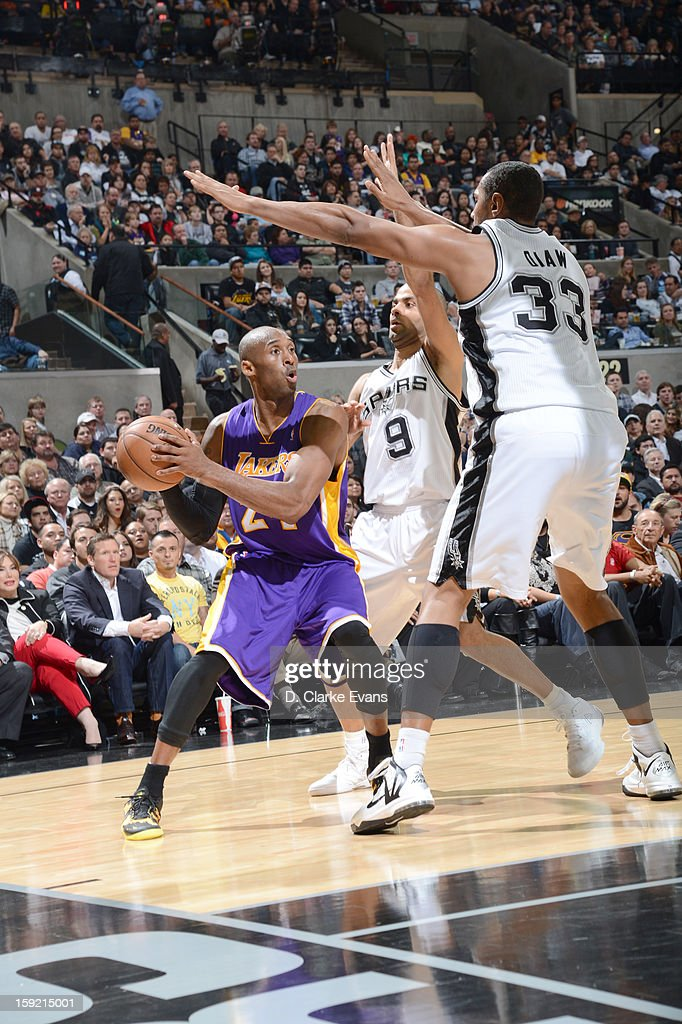 Kobe Bryant #24 of the Los Angeles Lakers protects the ball against Tony Parker #9 and Boris Diaw #33 of the San Antonio Spurs during the game on January 9, 2013 at the AT&T Center in San Antonio, Texas.