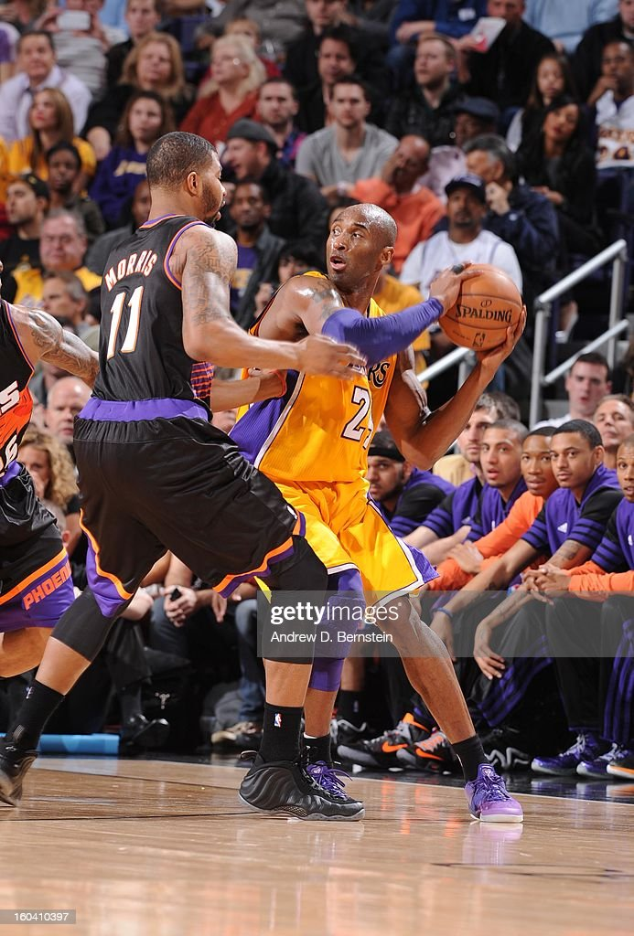 Kobe Bryant #24 of the Los Angeles Lakers protects the ball from Markieff Morris #11 of the Phoenix Suns during the game between the Los Angeles Lakers and the Phoenix Suns at US Airways Center on January 30, 2013 in Phoenix, Arizona.
