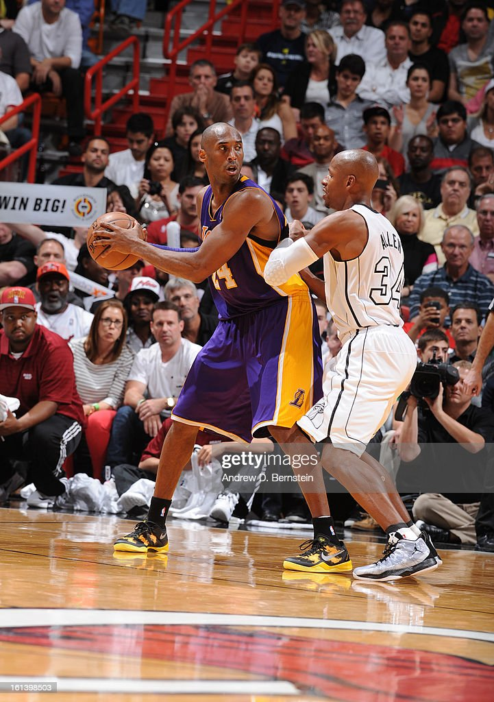 Kobe Bryant #24 of the Los Angeles Lakers protects the ball from Ray Allen #34 of the Miami Heat during a game between the Los Angeles Lakers and the Miami Heat on February 10, 2013 at American Airlines Arena in Miami, Florida.