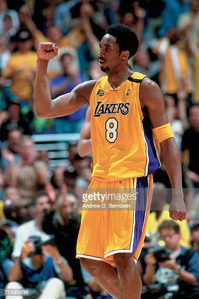 Kobe Bryant of the Los Angeles Lakers pumps his fist against the Indiana Pacers during Game Six of the 2000 NBA Finals on June 19 2000 at the Staples...