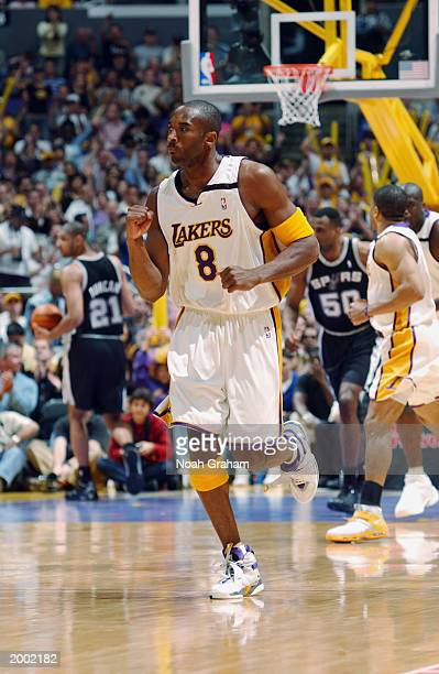 Kobe Bryant of the Los Angeles Lakers pumps his fist as he runs down the court against the San Antonio Spurs in Game four of the Western Conference...