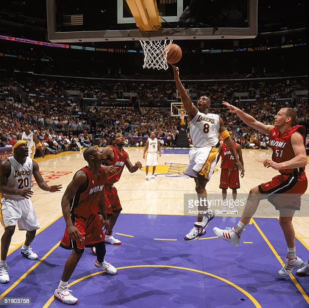 Kobe Bryant of the Los Angeles Lakers puts a shot up against the Miami Heat at Staples Center on December 25 2004 in Los Angeles California The Heat...