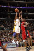 Kobe Bryant of the Los Angeles Lakers puts up a shot against the Toronto Raptors on January 22 2006 at Staples Center in Los Angeles California...