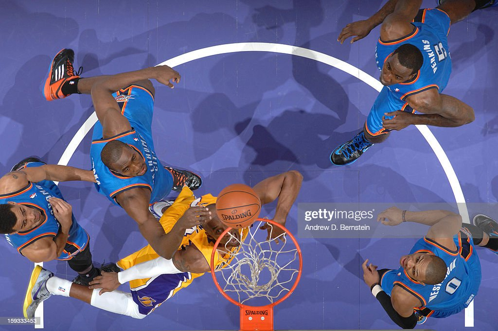 Kobe Bryant #24 of the Los Angeles Lakers puts up a shot against the Oklahoma City Thunder at Staples Center on January 11, 2013 in Los Angeles, California.