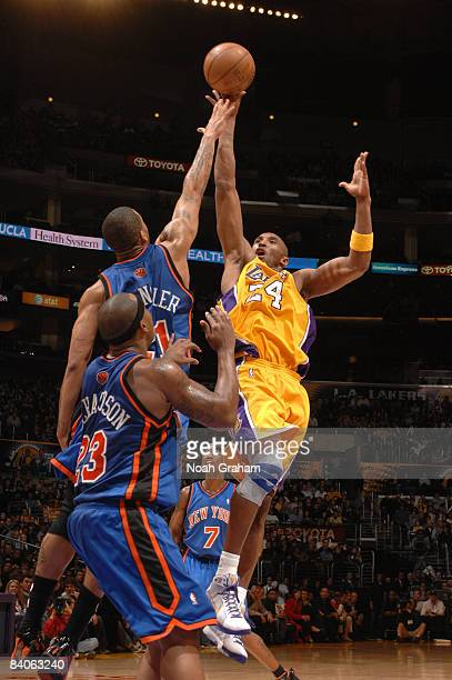 Kobe Bryant of the Los Angeles Lakers puts up a shot against Wilson Chandler of the New York Knicks at Staples Center December 16 2008 in Los Angeles...