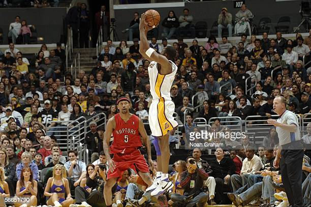 Kobe Bryant of the Los Angeles Lakers puts up a shot over Jalen Rose of the Toronto Raptors on January 22 2006 at Staples Center in Los Angeles...