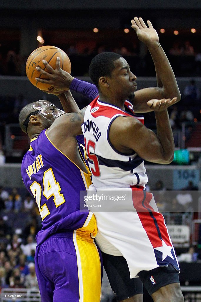 <a gi-track='captionPersonalityLinkClicked' href=/galleries/search?phrase=Kobe+Bryant&family=editorial&specificpeople=201466 ng-click='$event.stopPropagation()'>Kobe Bryant</a> #24 of the Los Angeles Lakers puts up a shot over the defense of <a gi-track='captionPersonalityLinkClicked' href=/galleries/search?phrase=Jordan+Crawford&family=editorial&specificpeople=4779380 ng-click='$event.stopPropagation()'>Jordan Crawford</a> #15 of the Washington Wizards during the first half at the Verizon Center on March 7, 2012 in Washington, DC.