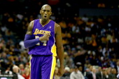 Kobe Bryant of the Los Angeles Lakers reacts after a call during their game against the Charlotte Bobcats at Time Warner Cable Arena on December 14...