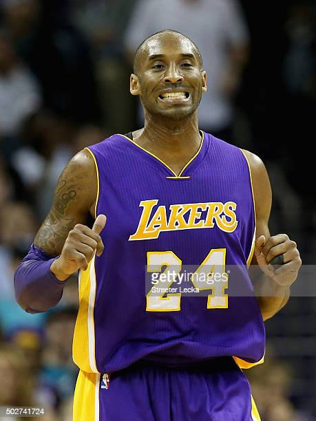 Kobe Bryant of the Los Angeles Lakers reacts after a play during their game against the Charlotte Hornets at Time Warner Cable Arena on December 28...
