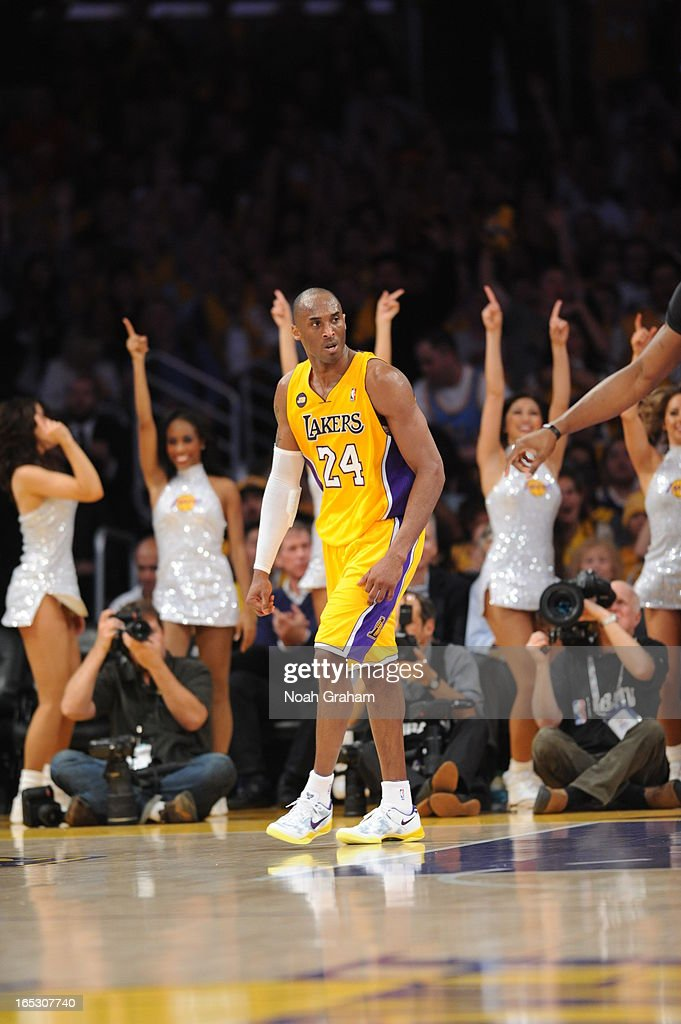 Kobe Bryant #24 of the Los Angeles Lakers reacts after dunking against the Dallas Mavericks at Staples Center on April 2, 2013 in Los Angeles, California.