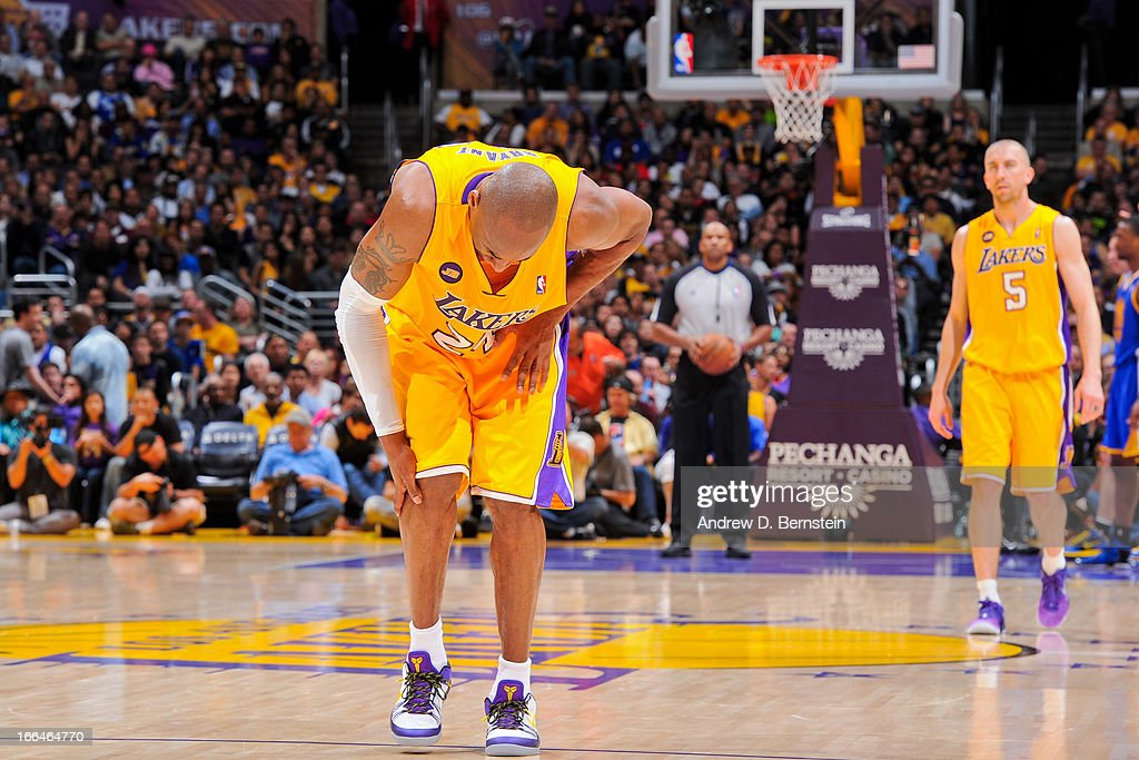 Kobe Bryant #24 of the Los Angeles Lakers reacts after getting injured during a game against the Golden State Warriors at Staples Center on April 12, 2013 in Los Angeles, California.