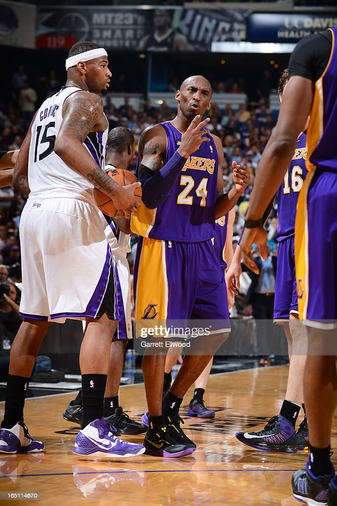 <a gi-track='captionPersonalityLinkClicked' href=/galleries/search?phrase=Kobe+Bryant&family=editorial&specificpeople=201466 ng-click='$event.stopPropagation()'>Kobe Bryant</a> #24 of the Los Angeles Lakers reacts after the play against <a gi-track='captionPersonalityLinkClicked' href=/galleries/search?phrase=DeMarcus+Cousins&family=editorial&specificpeople=5792008 ng-click='$event.stopPropagation()'>DeMarcus Cousins</a> #15 of the Sacramento Kings on March 30, 2013 at Sleep Train Arena in Sacramento, California.