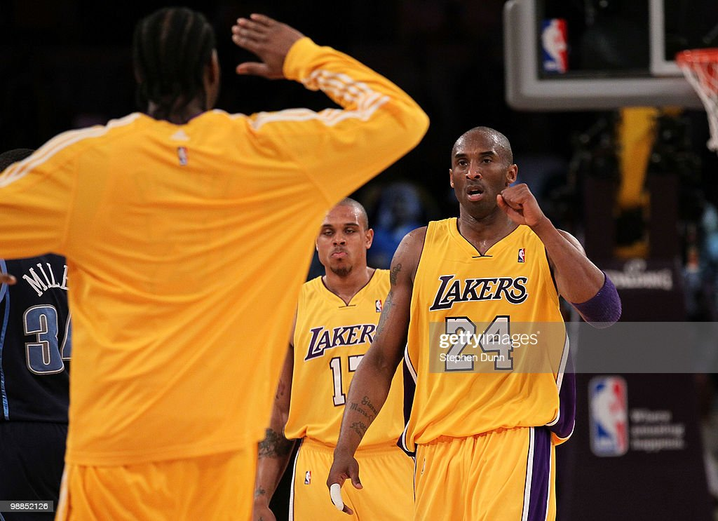 <a gi-track='captionPersonalityLinkClicked' href=/galleries/search?phrase=Kobe+Bryant&family=editorial&specificpeople=201466 ng-click='$event.stopPropagation()'>Kobe Bryant</a> #24 of the Los Angeles Lakers reacts during a timeout with teammate <a gi-track='captionPersonalityLinkClicked' href=/galleries/search?phrase=Josh+Powell&family=editorial&specificpeople=546627 ng-click='$event.stopPropagation()'>Josh Powell</a> #21 while taking on the Utah Jazz during Game Two of the Western Conference Semifinals of the 2010 NBA Playoffs at Staples Center on May 4, 2010 in Los Angeles, California.