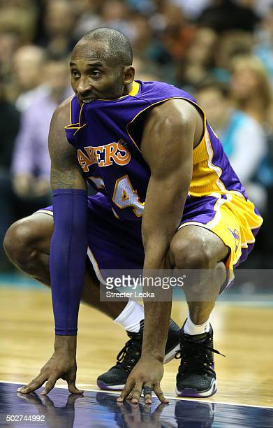 Kobe Bryant of the Los Angeles Lakers reacts during their game against the Charlotte Hornets at Time Warner Cable Arena on December 28 2015 in...