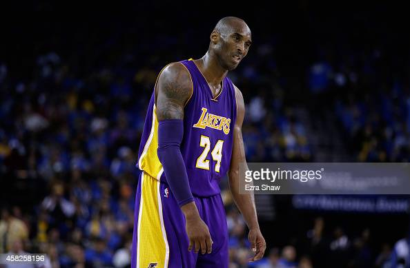 Kobe Bryant of the Los Angeles Lakers reacts during their loss to the Golden State Warriors at ORACLE Arena on November 1 2014 in Oakland California...