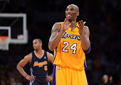 Kobe Bryant of the Los Angeles Lakers reacts late in the fourth quarter while taking on the Denver Nuggets in Game Seven of the Western Conference...