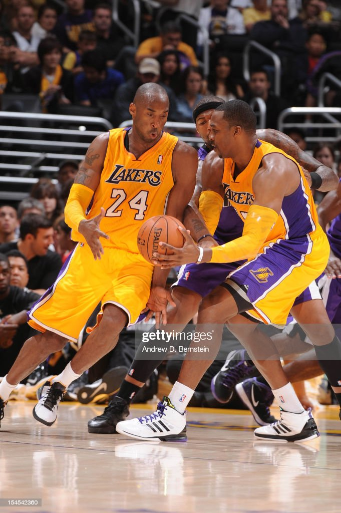 <a gi-track='captionPersonalityLinkClicked' href=/galleries/search?phrase=Kobe+Bryant&family=editorial&specificpeople=201466 ng-click='$event.stopPropagation()'>Kobe Bryant</a> #24 of the Los Angeles Lakers receives a pass from teammate <a gi-track='captionPersonalityLinkClicked' href=/galleries/search?phrase=Dwight+Howard&family=editorial&specificpeople=201570 ng-click='$event.stopPropagation()'>Dwight Howard</a> #12 while taking on the Sacramento Kings during a pre-season game at Staples Center on October 21, 2012 in Los Angeles, California.