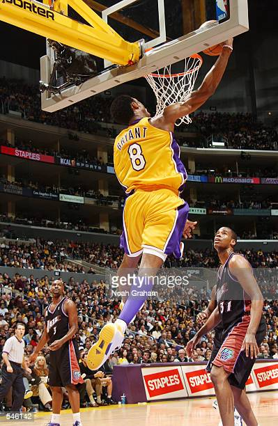 Kobe Bryant of the Los Angeles Lakers reverse dunks against the Utah Jazz during the second half of action at Staples Center in Los Angeles...