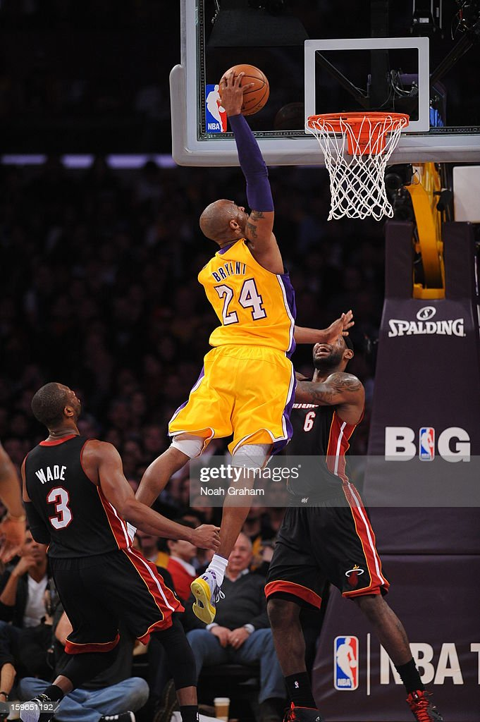 Kobe Bryant #24 of the Los Angeles Lakers rises for a dunk against LeBron James #6 of the Miami Heat at Staples Center on January 15, 2013 in Los Angeles, California.