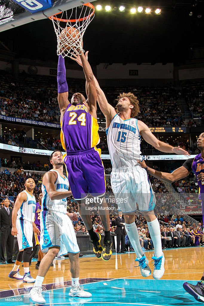 Kobe Bryant #24 of the Los Angeles Lakers rises for a dunk against Robin Lopez #15 of the New Orleans Hornets on March 6, 2013 at the New Orleans Arena in New Orleans, Louisiana.
