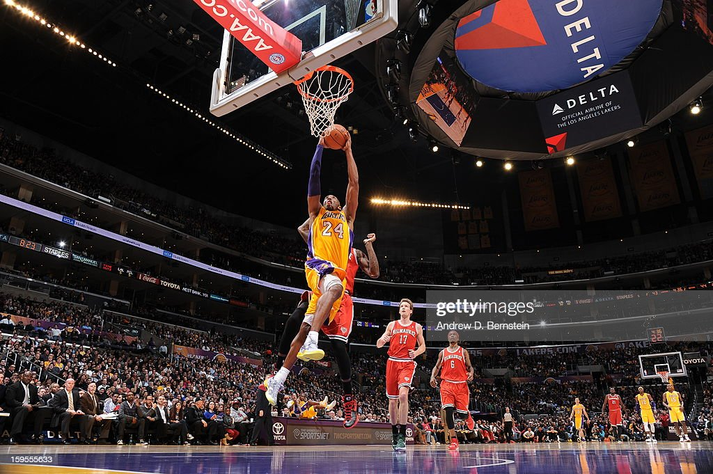 Kobe Bryant #24 of the Los Angeles Lakers rises for a dunk against the Milwaukee Bucks at Staples Center on January 15, 2013 in Los Angeles, California.