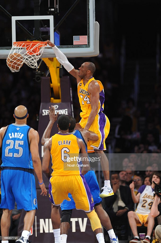 Kobe Bryant #24 of the Los Angeles Lakers rises for a dunk against the Dallas Mavericks at Staples Center on April 2, 2013 in Los Angeles, California.
