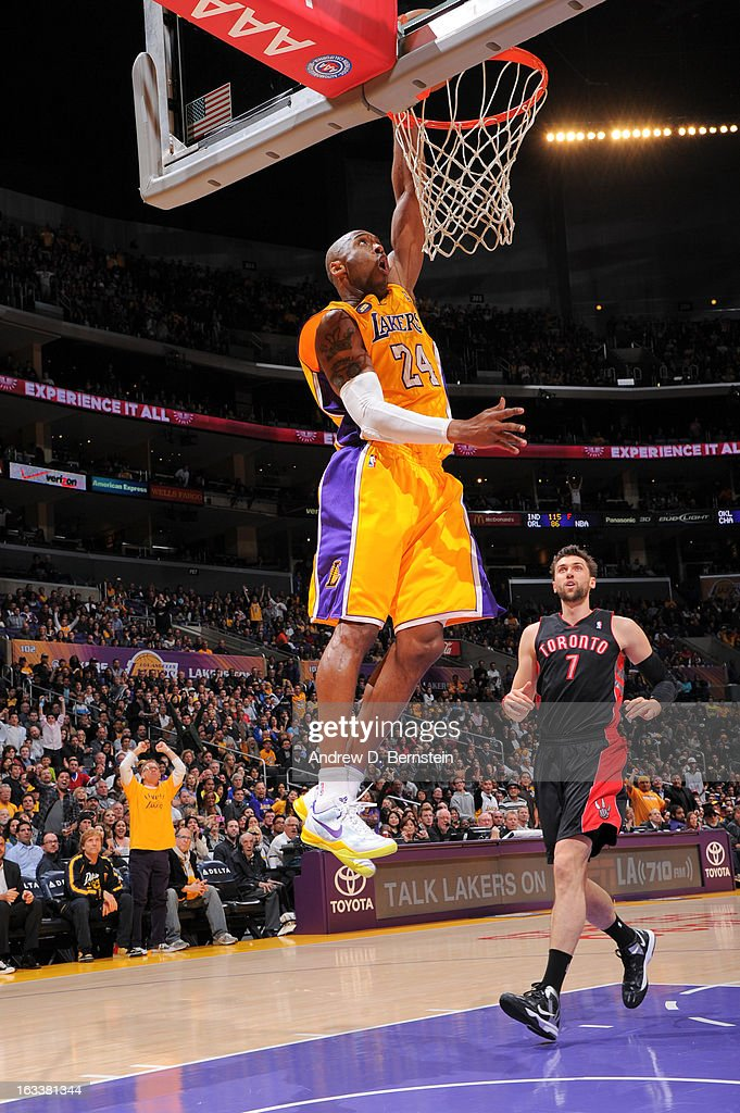 Kobe Bryant #24 of the Los Angeles Lakers rises for a dunk ahead of Andrea Bargnani #7 of the Toronto Raptors at Staples Center on March 8, 2013 in Los Angeles, California.