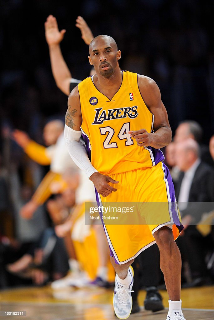 Kobe Bryant #24 of the Los Angeles Lakers runs back on defense after making a three-pointer against the New Orleans Hornets at Staples Center on April 9, 2013 in Los Angeles, California.