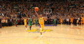 Kobe Bryant of the Los Angeles Lakers runs the ball up the court as he and hi team take the win over the Boston Celtics in Game Seven of the 2010 NBA...