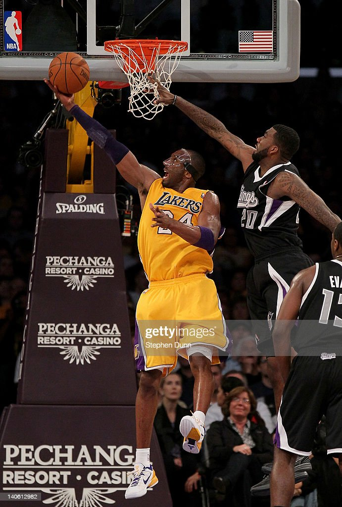 Kobe Bryant #24 of the Los Angeles Lakers scores a basket against donte Greene #20 of the Sacramento Kings at Staples Center on March 2, 2012 in Los Angeles, California. The Lakers won 115-107.