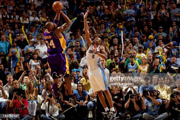 Kobe Bryant of the Los Angeles Lakers scores against Arron Afflalo of the Denver Nuggets in Game Six of the Western Conference Quarterfinals in the...