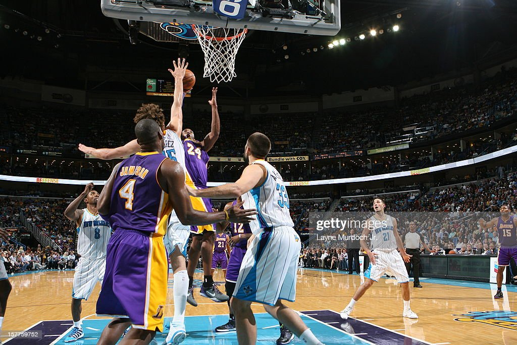 <a gi-track='captionPersonalityLinkClicked' href=/galleries/search?phrase=Kobe+Bryant&family=editorial&specificpeople=201466 ng-click='$event.stopPropagation()'>Kobe Bryant</a> #24 of the Los Angeles Lakers scores his 30,000th point during the game between the New Orleans Hornets and the Los Angeles Lakers on December 5, 2012 at the New Orleans Arena in New Orleans, Louisiana.