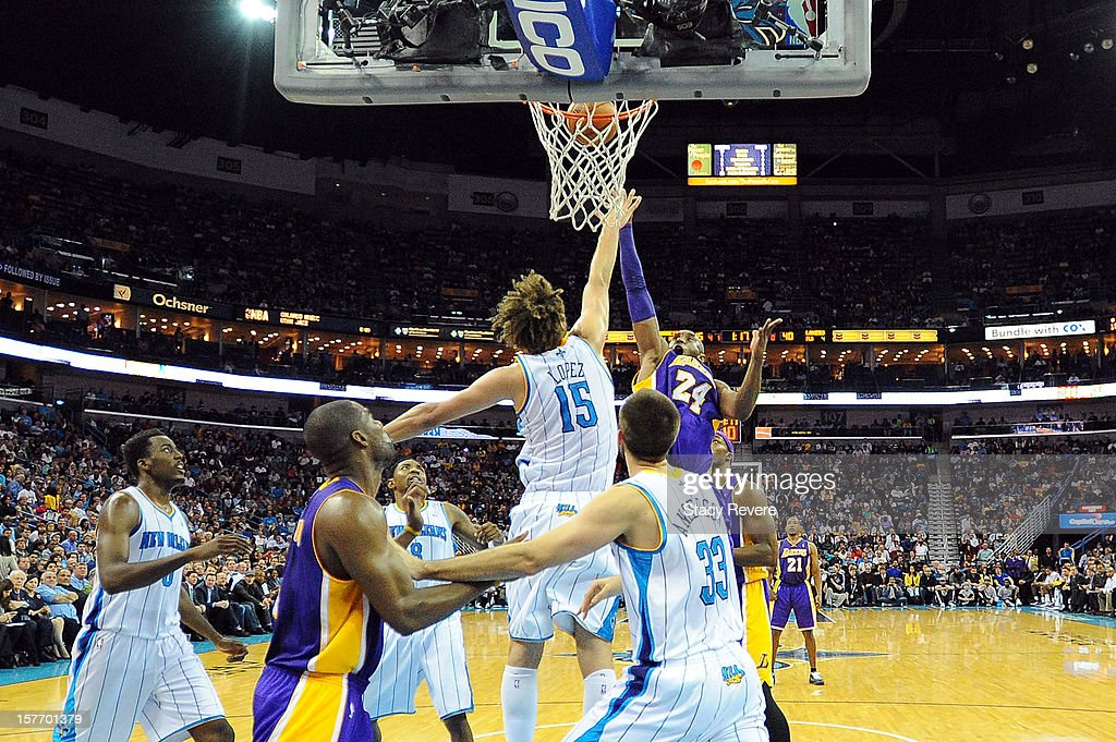 Kobe Bryant of the Los Angeles Lakers scores this 30000th point over Robin Lopez of the New Orleans Hornets at New Orleans Arena on December 5 2012...
