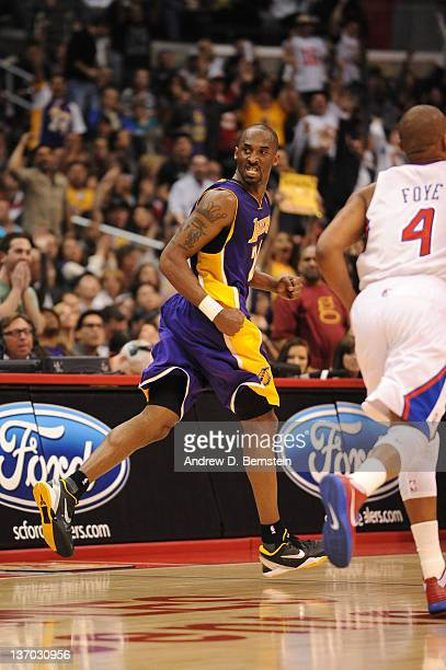 Kobe Bryant of the Los Angeles Lakers scowls after making a shot against the Los Angeles Clippers at Staples Center on January 14 2012 in Los Angeles...