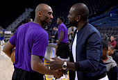 Kobe Bryant of the Los Angeles Lakers shakes hands with former Golden State Warriors Jason Richardson prior to the start of the game at ORACLE Arena...