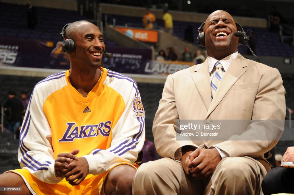 <a gi-track='captionPersonalityLinkClicked' href=/galleries/search?phrase=Kobe+Bryant&family=editorial&specificpeople=201466 ng-click='$event.stopPropagation()'>Kobe Bryant</a> #24 of the Los Angeles Lakers shares a laugh with former Laker Earvin Johnson during a postgame interview after defeating the San Antonio Spurs in Game Two of the Western Conference Finals during the 2008 NBA Playoffs at Staples Center on May 23, 2008 in Los Angeles, California.