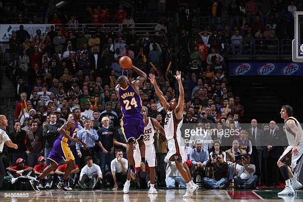 Kobe Bryant of the Los Angeles Lakers shoots a buzzerbeating jumpshot against Charlie Bell of the Milwaukee Bucks to win the game 106105 in overtime...