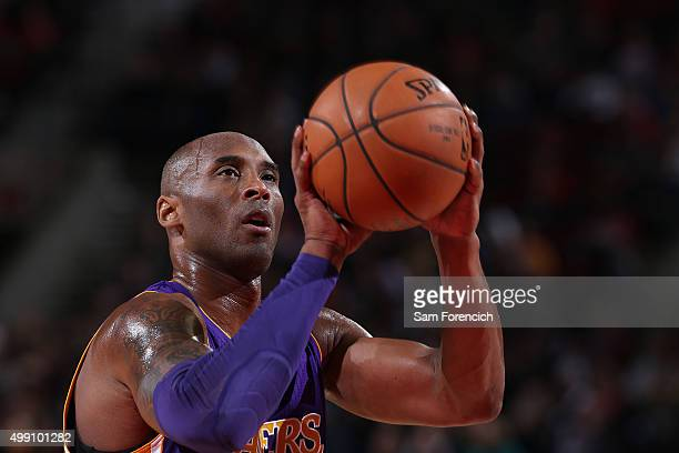 Kobe Bryant of the Los Angeles Lakers shoots a free throw during the game against the Portland Trail Blazers on November 28 2015 at the Moda Center...