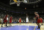 Kobe Bryant of the Los Angeles Lakers shoots a free throw for his 81st point against the Toronto Raptors on January 22 2006 at Staples Center in Los...