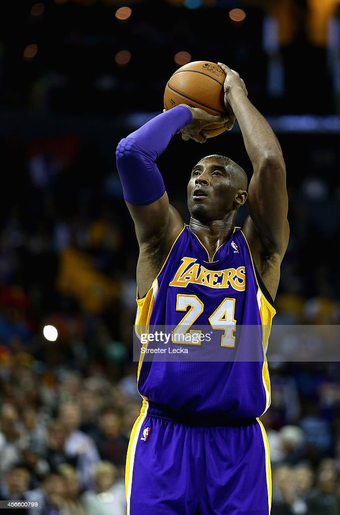 <a gi-track='captionPersonalityLinkClicked' href=/galleries/search?phrase=Kobe+Bryant&family=editorial&specificpeople=201466 ng-click='$event.stopPropagation()'>Kobe Bryant</a> #24 of the Los Angeles Lakers shoots a free throw late in the fourth quarter against the Charlotte Bobcats to give his team the lead at Time Warner Cable Arena on December 14, 2013 in Charlotte, North Carolina.