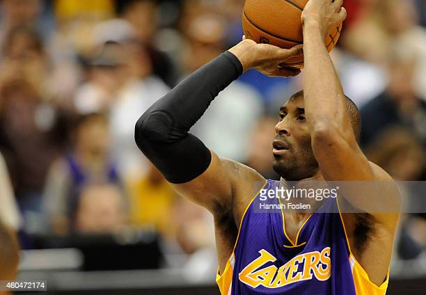 Kobe Bryant of the Los Angeles Lakers shoots a free throw to tie Michael Jordan on the alltime scoring list during the second quarter of the game...
