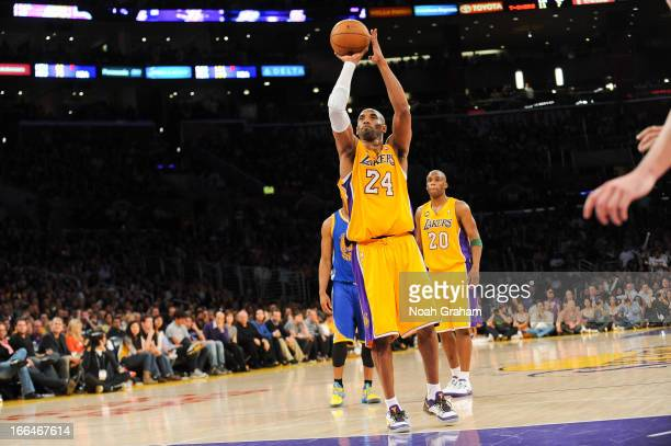 Kobe Bryant of the Los Angeles Lakers shoots a freethrow after sustaining an injury during a game against the Golden State Warriors at Staples Center...