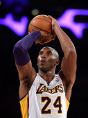 Kobe Bryant of the Los Angeles Lakers shoots a freethrow against the Toronto Raptors during the first quarter at Staples Center on December 8 2013 in...