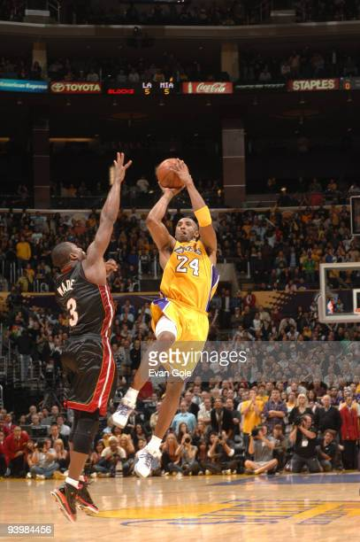 Kobe Bryant of the Los Angeles Lakers shoots a lastsecond three pointer against Dwyane Wade of the Miami Heat to win the game at Staples Center on...