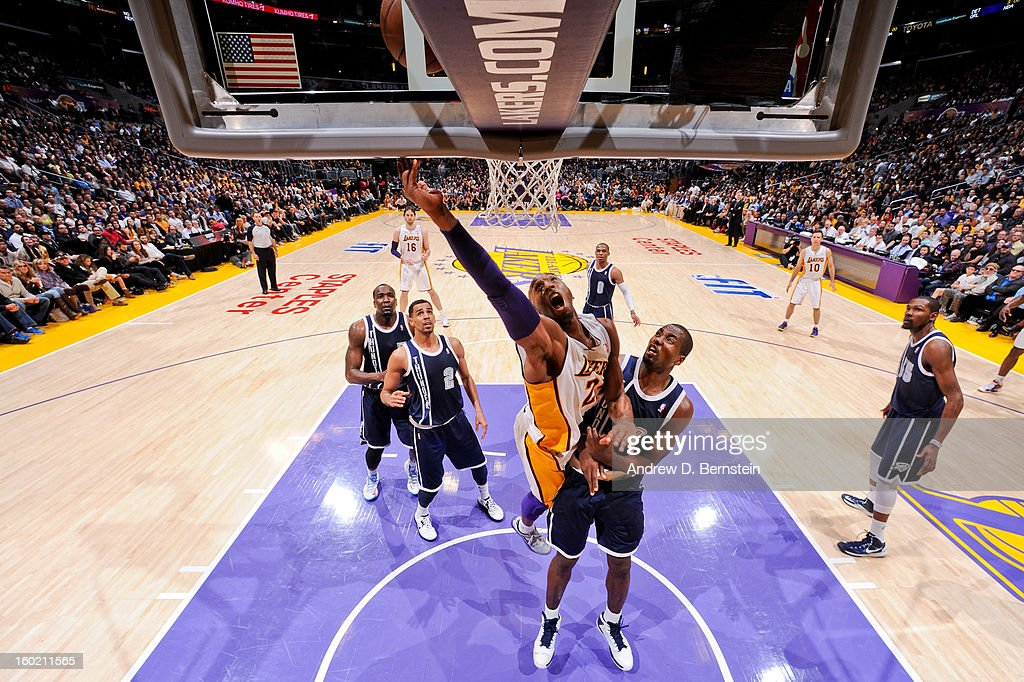 Kobe Bryant #24 of the Los Angeles Lakers shoots a layup against Serge Ibaka #9 of the Oklahoma City Thunder at Staples Center on January 27, 2013 in Los Angeles, California.